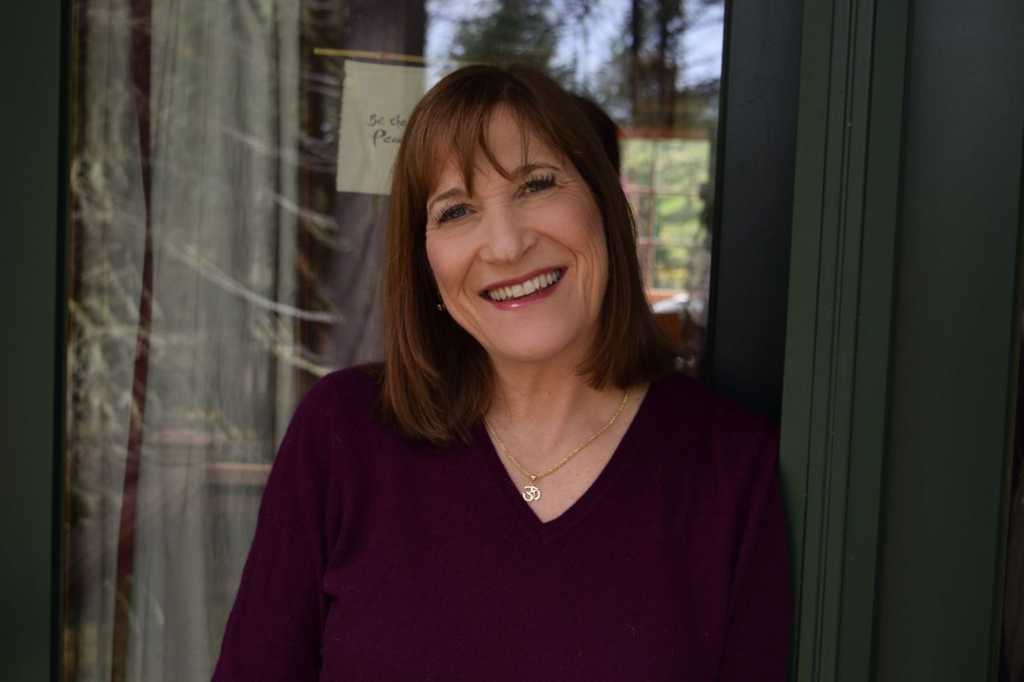 An image of Wendy Stgar, CEO of Good Clean Love, smiling