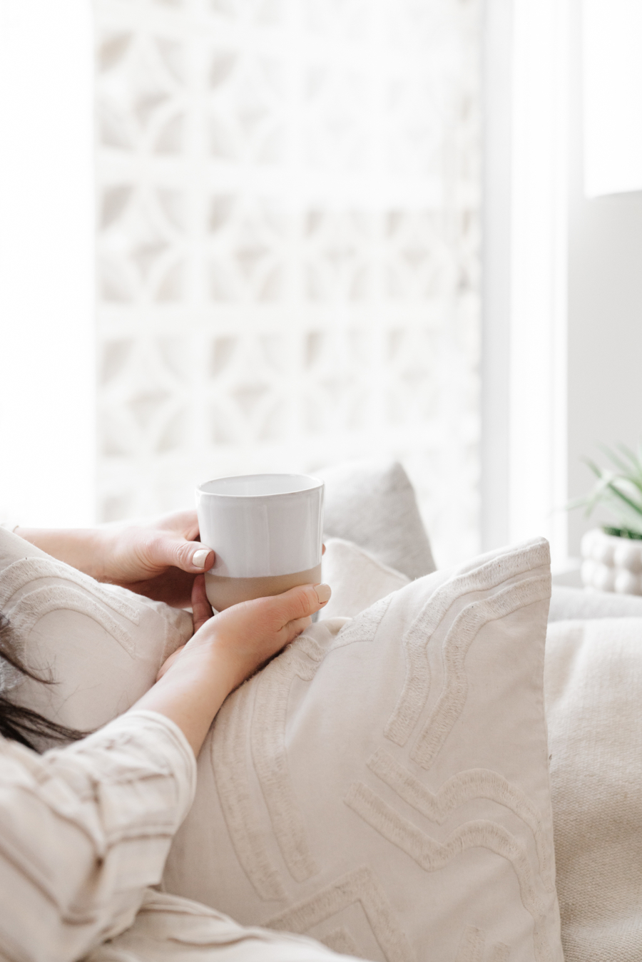woman staying at home holding a cup of tea